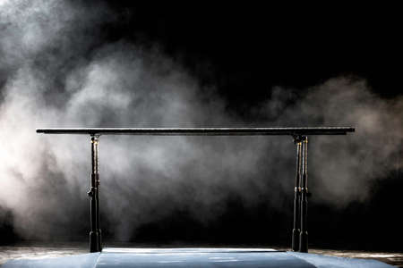 Gymnastic parallel bars. Isolated on black background with fog, Banque d'images