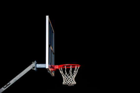 Red basketball hoop isolated on black. Basketball ring. With copy space.
