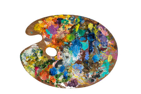 Artist palette with various colors isolated over white background. With Clipping Path.