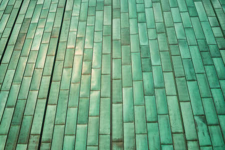 Green metal wall tiles, detail facade, modern constrution.