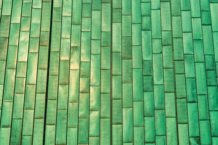 Green metal wall tiles, detail facade, modern constrution