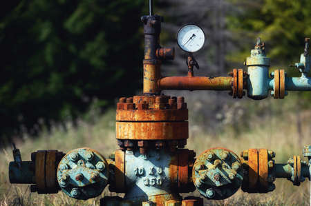 Oil pump. Oil industry equipment in Carpathian mountains.