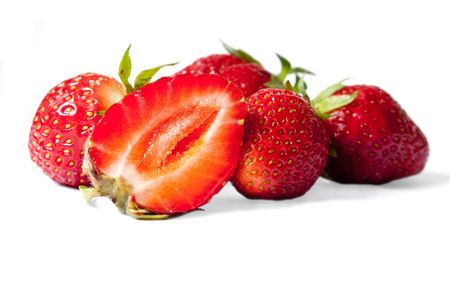 Some strawberries, with a half, with a shade on a white background Stock Photo