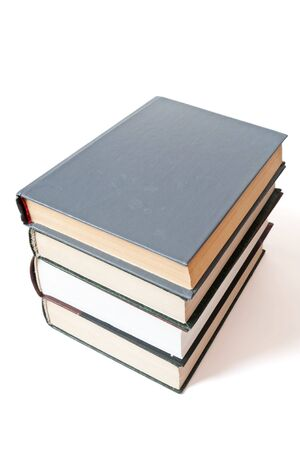 Four books an equal pile with a shade on a white background Stock Photo