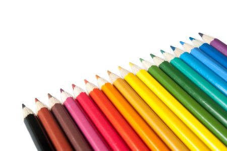Colour pencils as a rainbow with a shade on a white background Stock Photo
