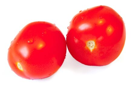Two red tomatoes with a shade on a white background