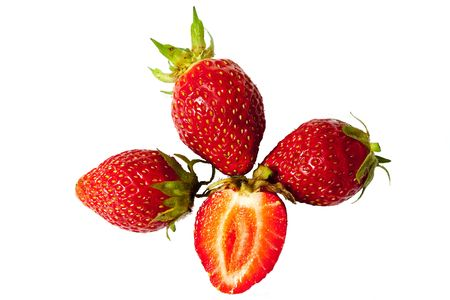 Three berries of a strawberry, with a half on a white background