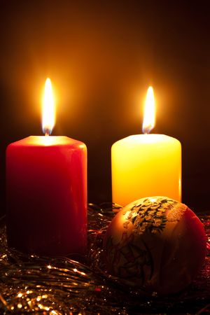 Group of two candles and glass fur-tree sphere in darkness Stock Photo - 7938328