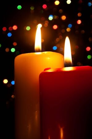 Two burning candles on a dark abstract background Stock Photo - 10367597