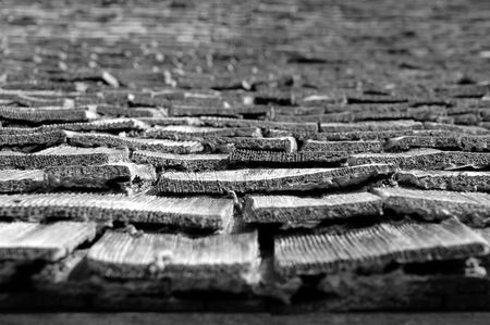 crooked: Old, worn crooked wooden shingles, in black and white