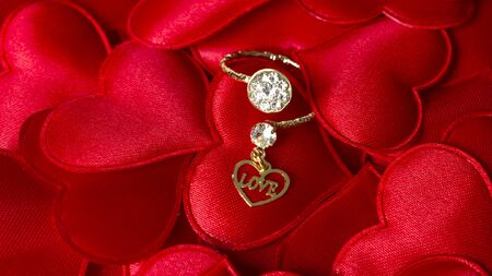 Diamond ring with a love heart symbol typed & red