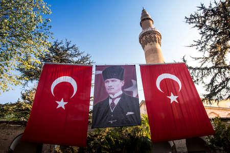 Emir Han's courtyard, Turkish flags and Atat?rk poster. Bursa, Turkey, 4.10.2017