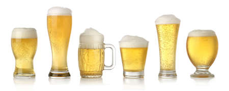 pint: Different glasses of cold lager beer isolated on white