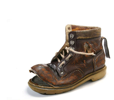 disenchantment: Old and bronken shoe. White background Stock Photo