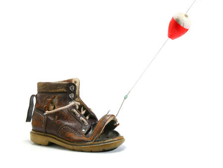 fishing pole: Catching an old shoe with a fishing pole. White background