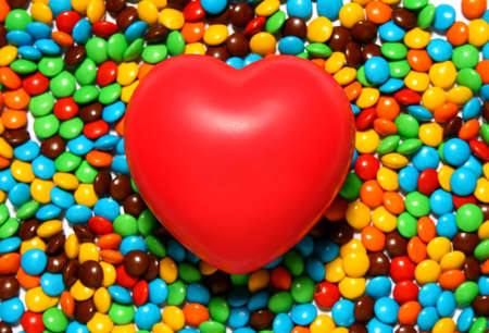 Colorful candy background with a red heart from my Valentine series
