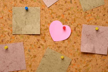 Cork board with heart shape sticky note photo
