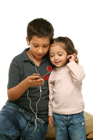 Brother and sister sharing a mp4 player photo