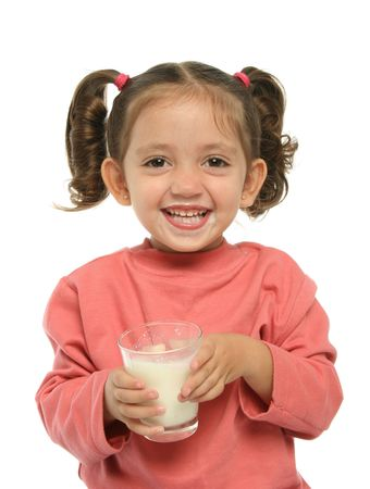 Toddler enjoying a glass of fresh milk photo