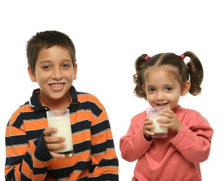 Children drinking milk together photo