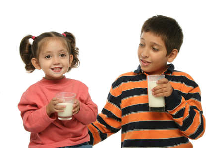 Children drinking milk together photo