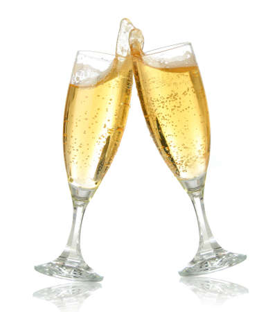 Pair of champagne flutes making a toast. Champagne splash