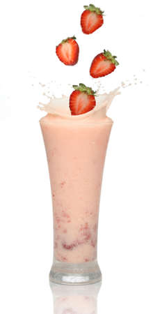 Strawberries splashing into a milkshake Stock Photo - 940816