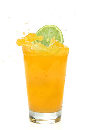 Lime splashing into an orange juice photo