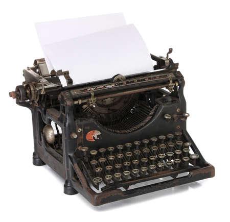 the typewriter: Una vieja m�quina de escribir con un papel en blanco