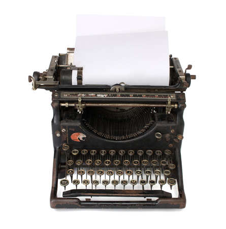 An old typewriter with a blank paper photo