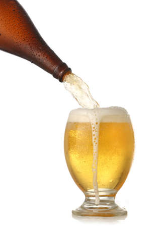 Pouring cold beer into glass isolated on white photo