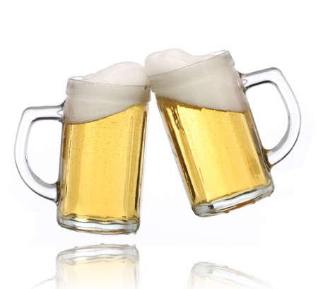 Pair of beer glasses making a toast. Beer splash Stock Photo - 4956173