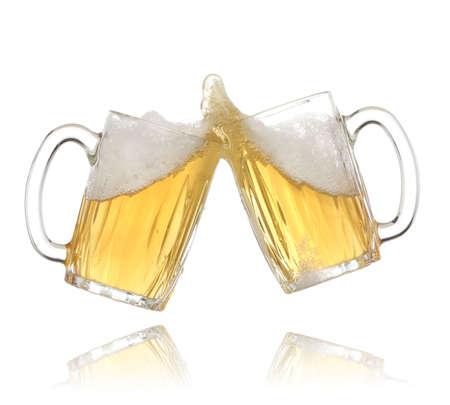 bitter: Pair of beer glasses making a toast. Beer splash Stock Photo