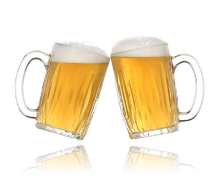 draughts: Pair of beer glasses making a toast. Beer splash Stock Photo