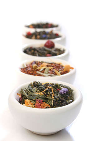 Various bowls of premiun tea leaves blends, over white Stock Photo