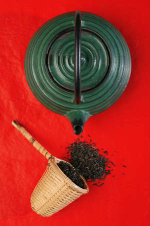 infuser: Chinese teapot and a wicker scoop with herb tea leaves. More in gallery