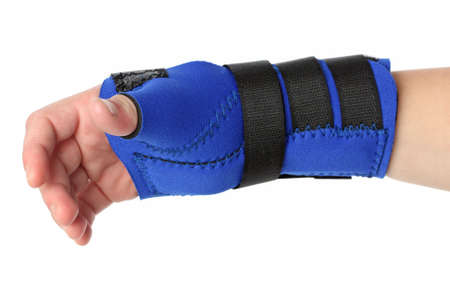 recuperation: Human hand with a wrist brace, orthopeadic equipment over white