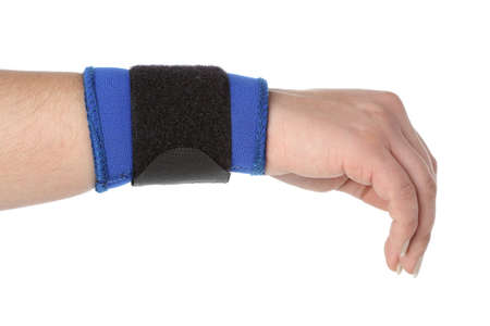 Human hand with a wrist brace, orthopeadic equipment over white photo