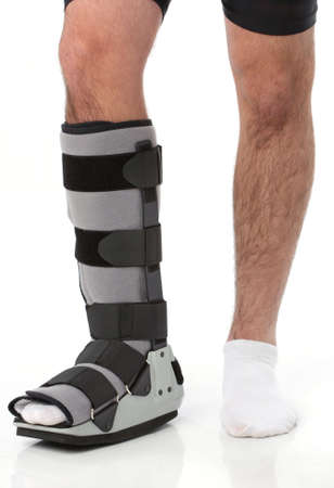 Man with an ankke brace over white Stock Photo - 5735857