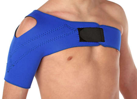 orthopaedic: Patient wearing a shoulder bandage, over white Stock Photo