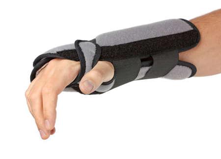 Human Hand mit einer Handgelenkstütze, orthopädischen Geräten over white