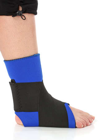 Foot with an ankle brace, over white photo