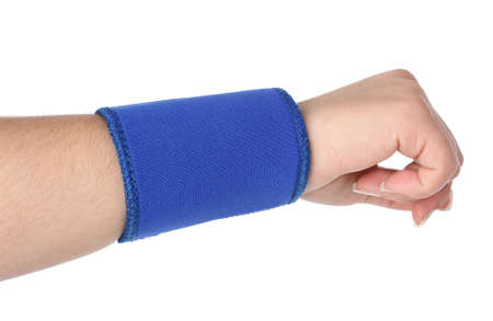 Human hand with a wrist brace, orthopeadic equipment over white Stock Photo - 5782143