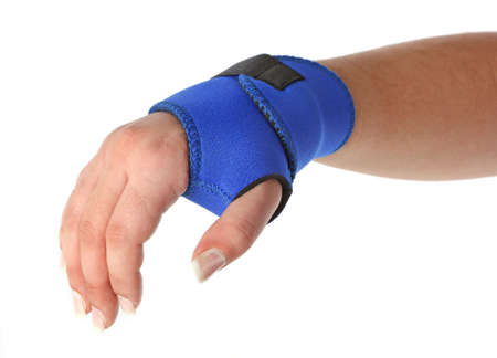 Human hand with a wrist brace, orthopeadic equipment over white Stock Photo - 5782144