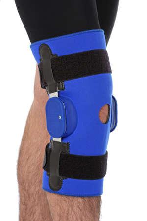 broken knee: Man wearing a leg brace, over white
