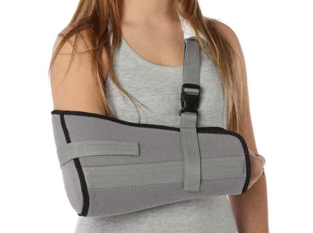 orthopaedic: Woman wearing an arm brace over white