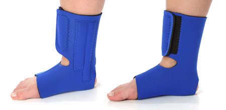 recuperation: Foot with an ankle brace, over white Stock Photo