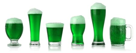 Different glasses of St. Patricks Day green beer