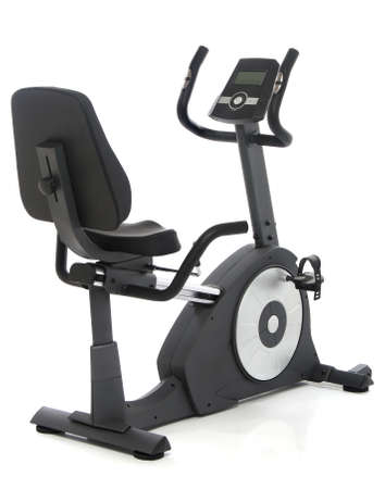 Stationary bike, gym machine over white background Stock Photo