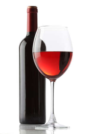Glass of red wine and a bottle isolated over white background Stock Photo